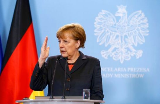 German Chancellor Angela Merkel addresses to media after meeting Polish Prime Minister Donald Tusk in Warsaw March 12, 2014. Merkel is visiting Poland to discuss the crisis in Ukraine. REUTERS/Kacper Pempel (POLAND - Tags: POLITICS)