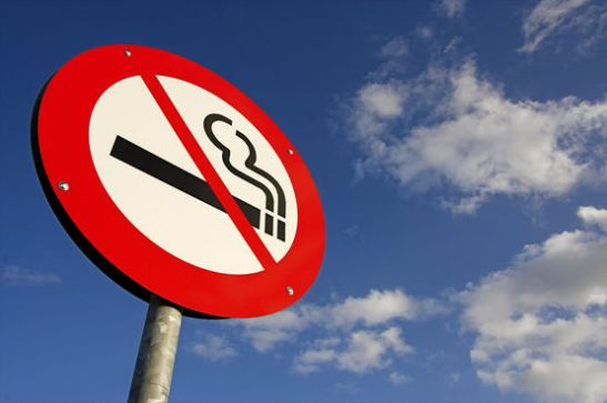 no smoking sign against the danish blue sky