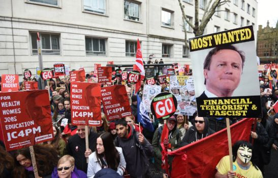 epa05262175 Protestors hold placards during an Anti-Austerity National demonstration in London, Britain, 16 April 2016. The march under the slogan,'Health, Homes, Jobs and Education, Cameron Must Go, Tories Out!' was organized by the People's Assembly against Austerity. EPA/FACUNDO ARRIZABALAGA