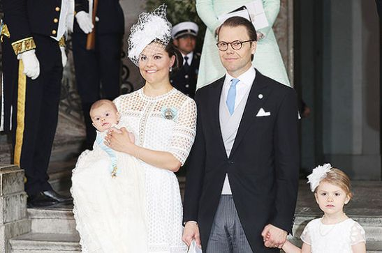 STOCKHOLM, SWEDEN - MAY 27: Crown Princess Victoria of Sweden holds Prince Oscar, Duke of Skane and Prince Daniel, Duke of Vastergotland with Princess Estelle of Sweden are seen after the ceremony at Royal Palace of Stockholm for the Christening of Prince Oscar of Sweden on May 27, 2016 in Stockholm, Sweden. (Photo by Andreas Rentz/Getty Images)